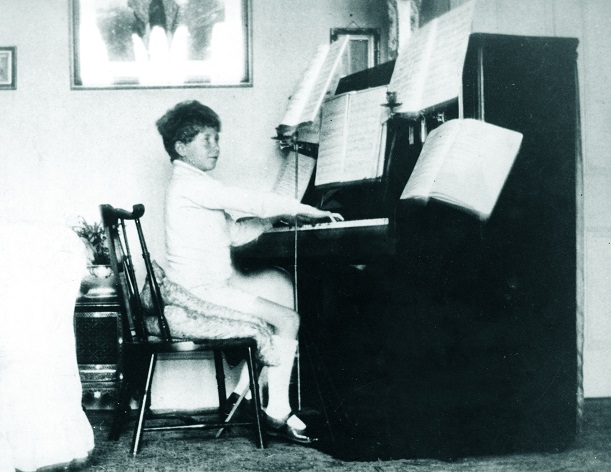 Britten playing piano at home, 1921